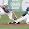 Kenny May, of WV Miners, left, tries to put a tag on, Steven Pallares, of Quincy Gems.<br /> Rick Barbero/The Register-Herald