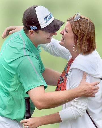 Sam O'Dell, left, embraces his wife, Leigh Ann O'Dell, right, on #18 green after winning the 2013 WV Amateur at the Greenbrier on Thursday afternoon. F. Brian Ferguson/The Register-Herald
