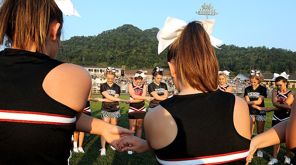 Westside and Liberty Cheerleaders met at midfield for a prayer prior to Fridays game in Clearfork. F. Brian Ferguson/The Register-Herald