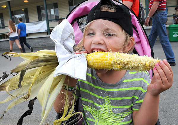 Allyson Harris, 4, daughter of Damon and Carla Harris, of Floyd, Va. eats a roasted ear of corn at the West Virginia State in Fairlea.<br /> Rick Barbero/The Register-herald