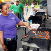 Latisha Timbers grills up the dogs during Saturday's Back to School Bash at Heart of Gold Ministries on South Kanawha Street F. Brian Ferguson/The Register-Herald