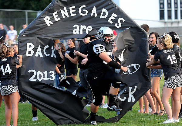 Westside's #55 Matt Harless leads his team as they get ready to play Liberty for the first game of the season in Clearfork. F. Brian Ferguson/The Register-Herald