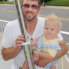 Mark Hurt and his 1-year-old son Ian Hurt, both of Oak Hill proudly pose with Ian's First Place Trophey that he won at Saturday's Sweet Frogs pageant. F. Brian Ferguson/The Register-Herald
