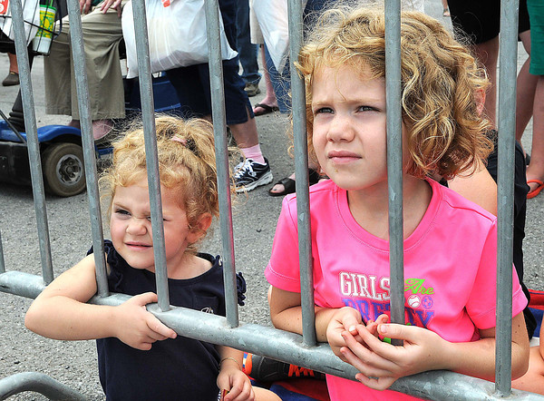 Mady and Ava Goad, daughters of Jeanette Goad, of Galax Va, watche watch the All American Stunt Show, The Nerveless Nocks at the West Virginia State in Fairlea.<br /> Rick Barbero/The Register-herald