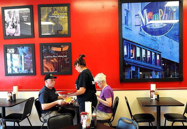 Famous Memphis landmarks are displayed in the dining room of the new Taste of Memphis Barbecue in the Beckley Crossing. F. Brian Ferguson/The Register-Herald