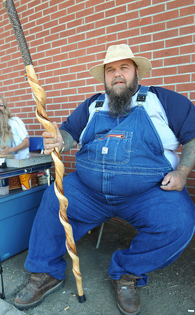 Craftsman Tiger Johnson of T&A Leather bought a hand-made cane from fellow craftsman Wayne Albright, not pictured, of Wayne's Wood Works during Saturday's Appalachian Festival at the Raleigh County Convention Center. F. Brian Ferguson/The Register-Herald