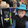 Devon Blevins, 2, son of Melissa Blevins, of Bluefield, tries on a cowboy hat at the West Virginia State Fair in Fairlea.<br /> Rick Barbero/The Register-Herald