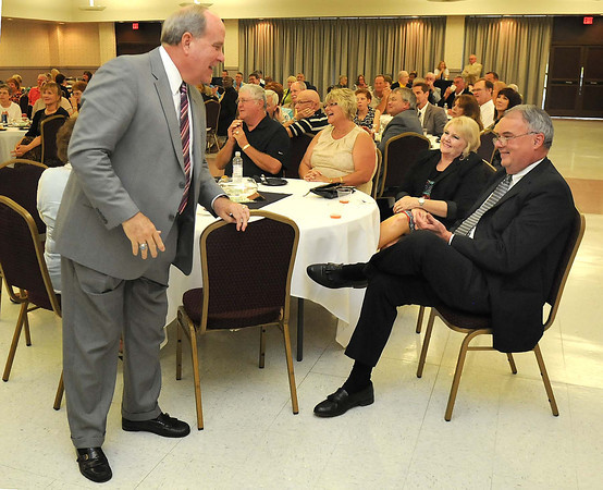 Beckley mayor Emmett Pugh, left, jokes with Gary Sutphin during Sutphin's retirement party at the Beckley Raleigh County Convention Center.<br /> Rick Barbero/The Register-Herald
