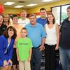 OMEGA & Little General host Make-A-Wish event. Pictured from left front row, Janet Vineyard, president OMEGA and Logan, 9, of Anstead, Make-A-Wish child,  middle row from left, Jim Meadows, manager Crab Orchard Little General, Kim Wayne, retail Little General, Danny Sullivan, retail merchantdise Little General, Jennifer Brooks, retail supervisor Little General and Dustin Darby, retail operation Little General, back row from left, Tambra Cheman, regional development & community liaison Make-A-Wish, Lars, 17, of Hinton, Make-A-Wish child and Brian Wagh, director of retail Little General.<br /> Rick Barbero/The Register-Herald