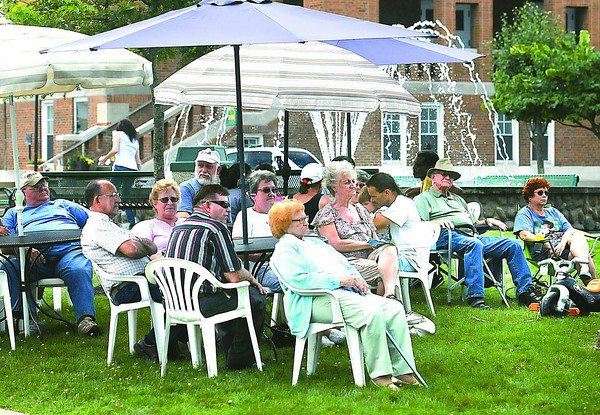 People listening to gospel music during Friday's in the Park in Word Park on Neville Street in Beckley.<br /> Rick Barbero/The Register-Herald.com
