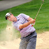 Sam O'Dell, of Hurricane WV, hits out of the trap on the par 4, 14th hole during the third round of the West Virginia State Amateur held the Greenbrier Course at The Greenbrier Resort in White Sulphur Springs, WV Wednesday afternoon. Sam O'Dell is leading by 9 strokes at 11 under par.<br /> Rick Barbero/The Register-Herald