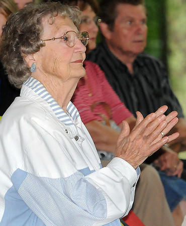Norma Stump, of Beckley, takes in the music during Saturday's Lilly Family Reunion. F. Brian Ferguson/The Register-Herald