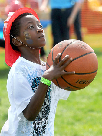 Jaden Lowe, 10, of Beckley enjoys shooting hoops during Saturday's Day of Hope event at the YMCA Soccer Complex. F. Brian Ferguson/The Register-Herald