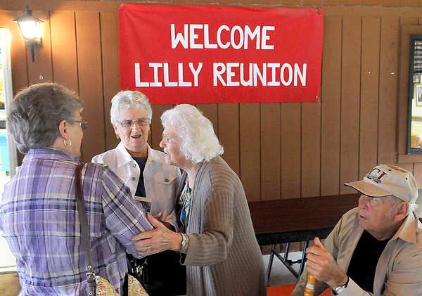 Marilee Bennett, of Flattop, from left, Joyce Goldie, of Charleston, Maryfrances Lilly, of Cool Ridge, and Eugene Lilly of Flattop compare notes for another year.during Saturday's Lilly Family Reunion. F. Brian Ferguson/The Register-Herald