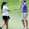 Runner-up Kimberly Eaton, left, of Sheperdstown shakes hands with the winner of Thursday's final round of the WV Woman's Amateur at the Resort at Glade, Sydney Snodgrass of Harisville, right, on the #18 green. F. Brian Ferguson/The Register-Herald
