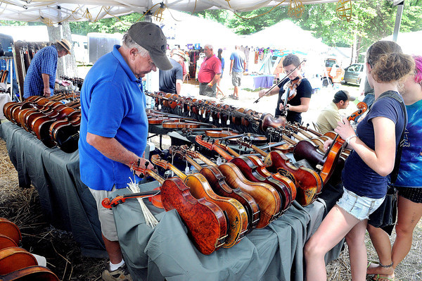 Bluegrass fans from around the world checked out the vast amont of instruments at the Appalachian String Band Festival at Camp Washington Carver.. F. Brian Ferguson/The Register-Herald