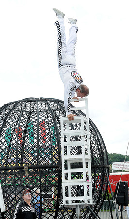 Michelangelo Nock, with The Nerveless Nocks Productions, does a handstand on a stack of chairs at the West Virginia State in Fairlea.<br /> Rick Barbero/The Register-herald