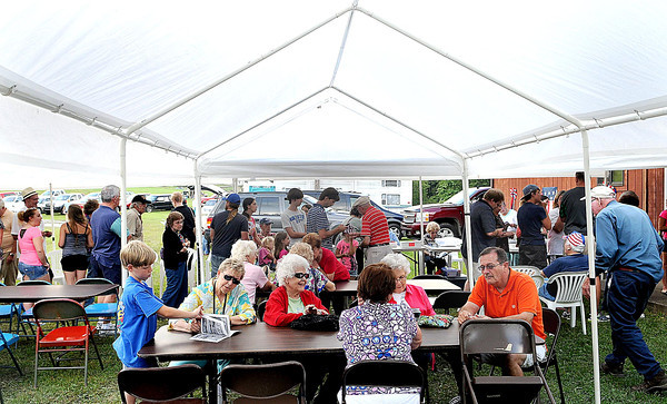 Lilly's gathered under tents and indoors at the Lilly reunion grounds in Flat Top for a large family meal on Friday to kick-off this weekends Lilly Family Reunion. F. Brian Ferguson/The Register-Herald