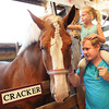 Karlie Osbourne, 4, sits on her father, Dustin Osbourne, of Nettie, shoulder and pets Cracker, a draft horse, at the West Virginia State Fair in Fairlea.<br /> Rick Barbero/The Register-Herald
