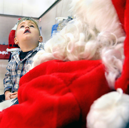 Hayden McCoy, 3, of Coal City had a few questions for Santa about his reindeer during Saturday morning's Breakfast with Santa at Beckley Area Regional Hospital F. Brian Ferguson/The Register-Herald