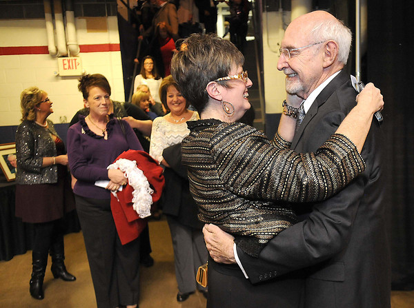 Teresa Neil, left, greets Jerry Rose during the YMCA of Southern West Virginia  Spirit of Beckley Community Service Award Banquet.<br /> Rick Barbero/The Register-Herald