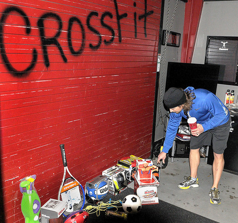 Greg Hewitt of Fayetteville brought a gift to the Beckley Crossfit before taking part in a joint workout-toy drive on Saturday. Members of the Beckley and Oak Hill crossfit brought sports related toys, to promote physical activity, that will be donated to Pinehaven Homeless Shelter. F. Brian Ferguson/The Register-Herald