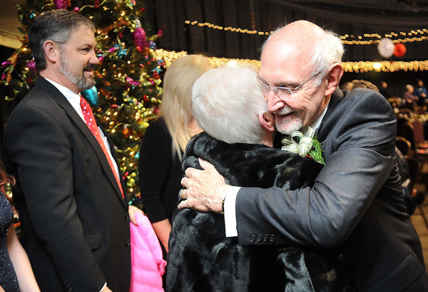 Jerry Rose gets greeted Phyliss Spurlock, of Beckley, during the YMCA of Southern West Virginia Spirit of Beckley Community Service Award dinner at the Beckley-Raleigh County Convention Center Monday night.<br /> Rick Barbero/The Register-Herald
