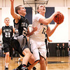 Westside's Jordan Browning drives to the basket as Tug Valley's Calvin Blankenship defends Friday night in Clear Fork.<br /> Brad Davis/The Register-Herald