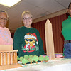 Manor House Gingerbread workers, (from left), Pat Cosby, Trudy Wardensky, and Jeanette Hamby stand behind this year's version of the Christmas Gingerbread house that they and residents of the House constructed. The theme for this year's house was Christmas in Washington D.C. F. Brian Ferguson/The Register-Herald
