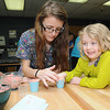 Emily Shumate, dental assistant student at ACT, left, makes a finger mold from Payton Porter's thumb, Raleigh County Headstart student.<br /> Rick Barbero/The Register-Herald