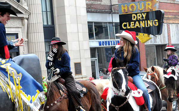 Members of the Shady Spring Rodeo team rode their horses on Saturday afternoon during the Beckley Christmas Parade. F. Brian Ferguson/The Register-Herald