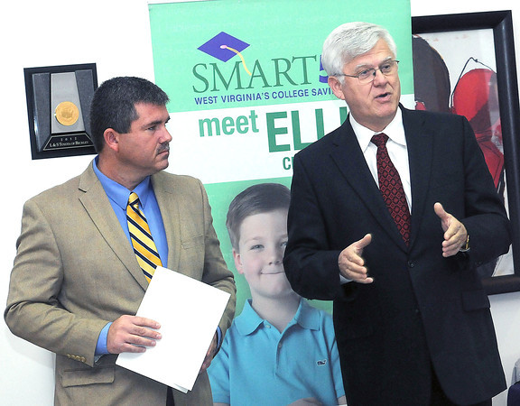 L&S Toyota Owner, Shawn Ball, left, and West Virginia Treasurer John Perdue, right announced, on Friday, a new matching program for dealership employees who are current or prospective Smart529 enrollees.  F. Brian Ferguson/The Register-Herald