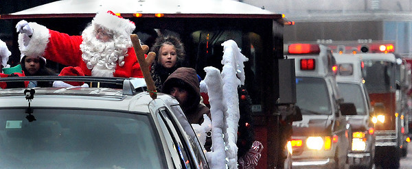 Santa had an ambulance escort on Saturday afternoon during the Beckley Christmas Parade. F. Brian Ferguson/The Register-Herald