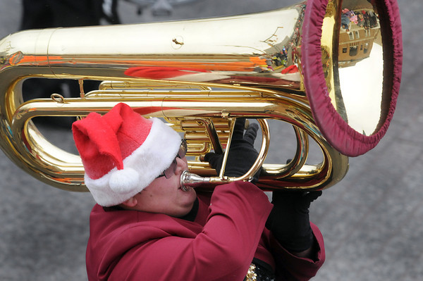 Members of the Woodrow Wilson Marching Band tried to stay warm on Saturday afternoon during the Beckley Christmas Parade. F. Brian Ferguson/The Register-Herald