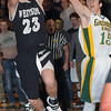 Westside;s #23 gos up for a shot as Greenbrier East's #15 defends during Friday evening action in Fairlea. F. Brian Ferguson/The Register-Herald