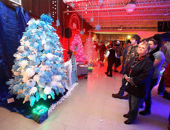 Visitors check out some of the unique Christmas tree designs on display during the 13th annual Festival of Trees at the Academy of Careers and Technology Tuesday night.<br /> Brad Davis/The Register-Herald