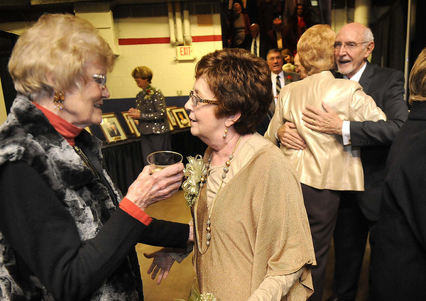 Mary Anne Hodson, of Beckley, left, speaks with Sherry Rose and her husband Jerry Rose get greeted by guests during the YMCA of Southern West Virginia Spirit of Beckley Community Service Award Banquet.<br /> Rick Barbero/The Register-Herald