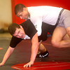 Independence wrestlers Jakob Cooper, top, and Conner Priddy practice Tuesdat evening in Coal City. The Patriots will take on Fairmont East a little over a week from now.<br /> Brad Davis/The Register-Herald