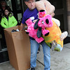 Volunteer Mike Stewart aided local residents carry toys to their cars on Sunday during the Wyoming County Toy Fund at Wyoming East High School. F. Brian Ferguson/The Register-Herald