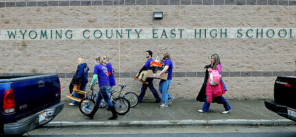 Volunteers aided local residents carry toys to their cars on Sunday during the Wyoming County Toy Fund at Wyoming East High School. F. Brian Ferguson/The Register-Herald