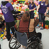 Volunteers aided local residents on Sunday during the Wyoming County Toy Fund at Wyoming East High School. F. Brian Ferguson/The Register-Herald