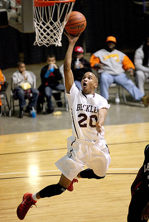 Woodrow Wilson's Jaylon Breckenridge scores on an uncontested layup against Oak Hill Saturday night at the Beckley-Raleigh County Convention Center.<br /> Brad Davis/The Register-Herald