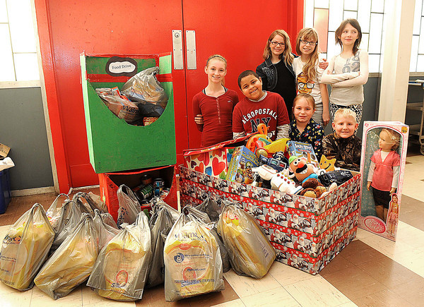 Bailey Heffernan, left front row, Jacob Walker, Abigail Humphrey, Wes Tucker, back row from left, Morgan Wilson, Haleigh Gilbert and Dawn Vance, they are part of Mabscott Elementary student government team that collected items for a food and toy drive they did for the United Way.<br /> Rick Barbero/The Register-Herald