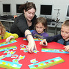 Rylie Hall, second from left, ACT student, works with from left, Payton, Bree and Jeremiah, Raleigh County Headstart students.<br /> Rick Barbero/The Register-Herald