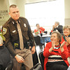 Frankie Shelton, Beckley PD, gets applauded after they announced he was the officer of the year during the Southern Regional Highway Safety Banquet held at the Beckley Moose Lodge.<br /> Rick Barbero/The Register-Herald