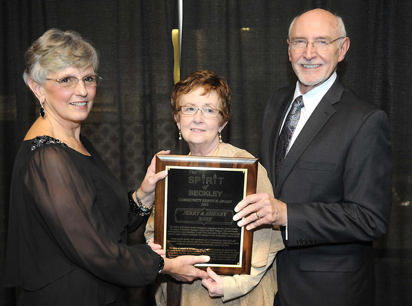 Pat Almond, left, presented Sherry and Jerry Rose with the YMCA of Southern West Virginia Spirit of Beckley Community Service Award.<br /> Rick Barbero/The Register-Herald