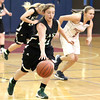 Wyoming East's Breanna Allen takes off down the court after intercepting a pass intended for Independence's Jordan Hall during the Warriors' blowout win against the Patriots Monday night in Coal City.<br /> Brad Davis/The Register-Herald