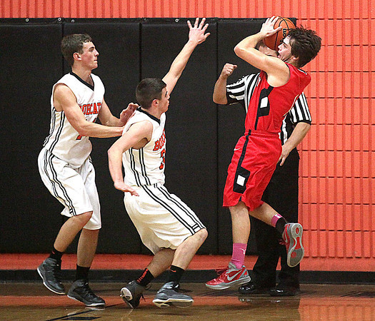 Liberty's #1 attempts to shoot as Summers County defenders Jacob Lively (#5) and Anthony Cales (#14) try to block it Tuesday night in Hinton.<br /> Brad Davis/The Register-Herald