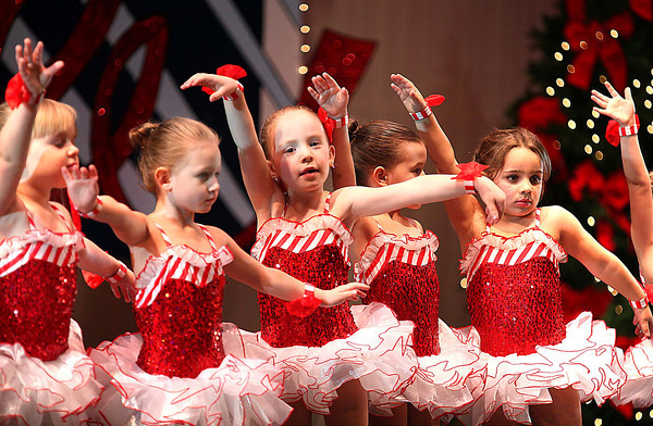 """Dancers perform during """"The Best Place to Celebrate Christmas"""" presented by Karen's Academy of Dance Saturday night at the Woodrow Wilson Auditorium.<br /> Brad Davis/The Register-Herald"""