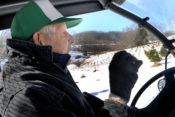 Piney Tree Farm owner, Charles Hudson drives around his Christmas tTree Farm in Piney View. F. Brian Ferguson/The Register-Herald